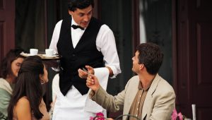 Hotel tips-waiter talking to people